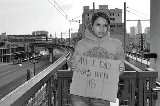Girl holding a sign that reads