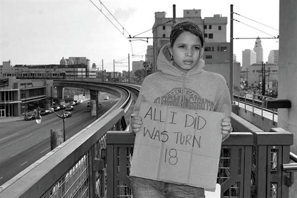 "Girl holding a sign that reads ""all I did was turn 18"""